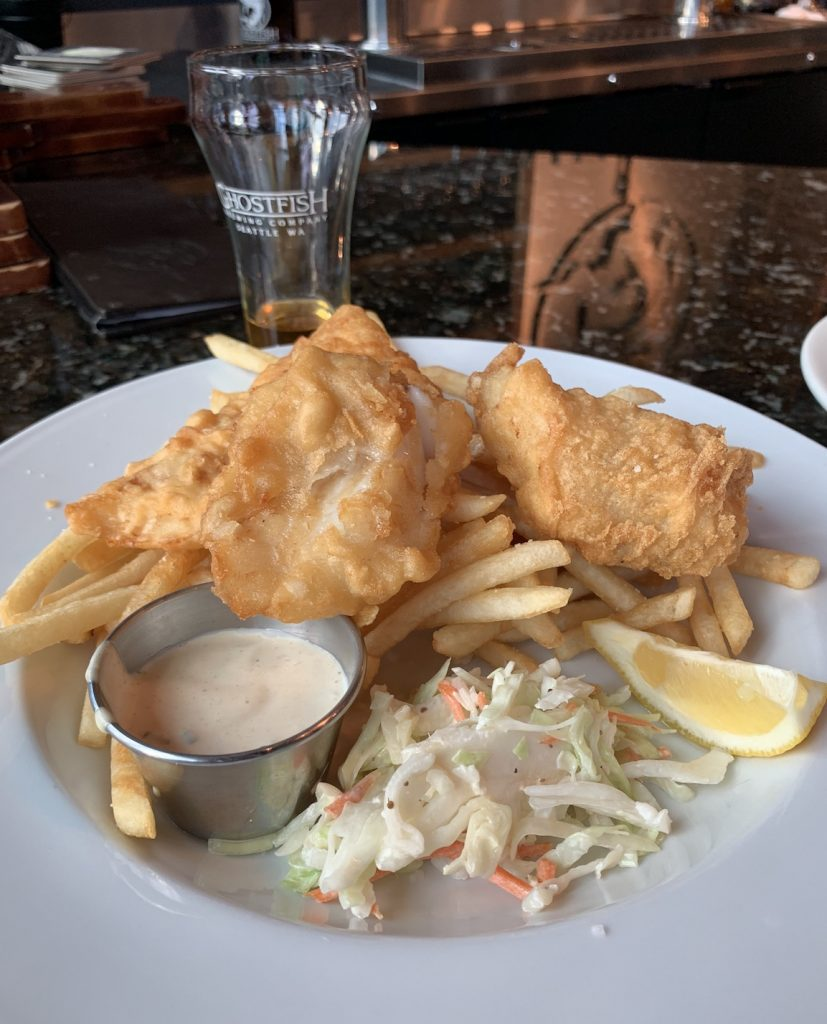 Ghostfish Brewery Fish and Chips on a white plate with coleslaw, the best gluten-free restaurant in Seattle
