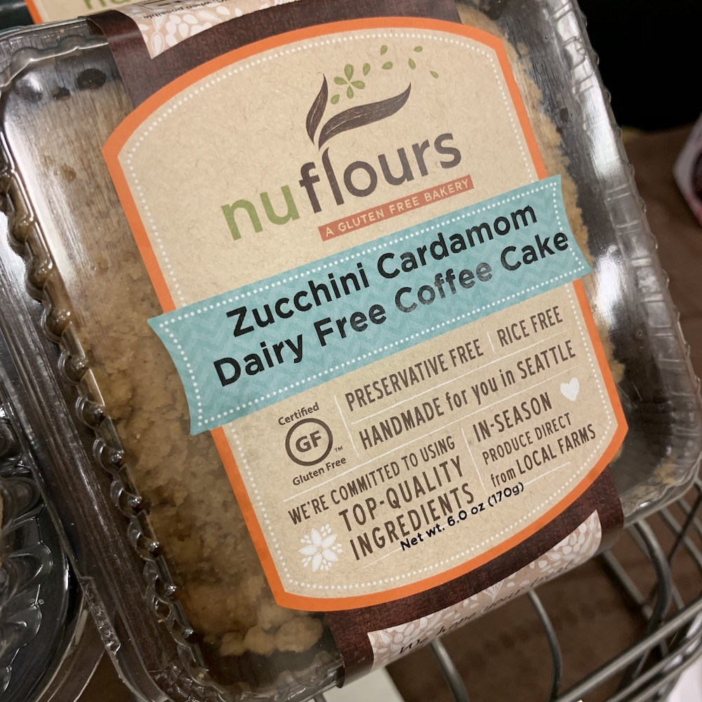 Outside packaging of nuflours a gluten free bakery zucchini cardamom dairy-free coffee cake, package shows certified gluten free label - nuflours is one of the best gluten-free bakeries in Seattle