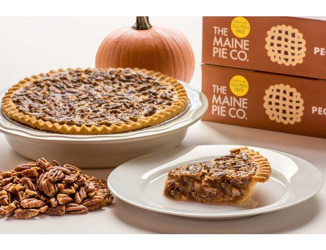 Photo from the Maine Pie Co. website showing a slice and and entire pie  of the pecan pie, with a pile of pecans and a highlight of the gluten free label on the box