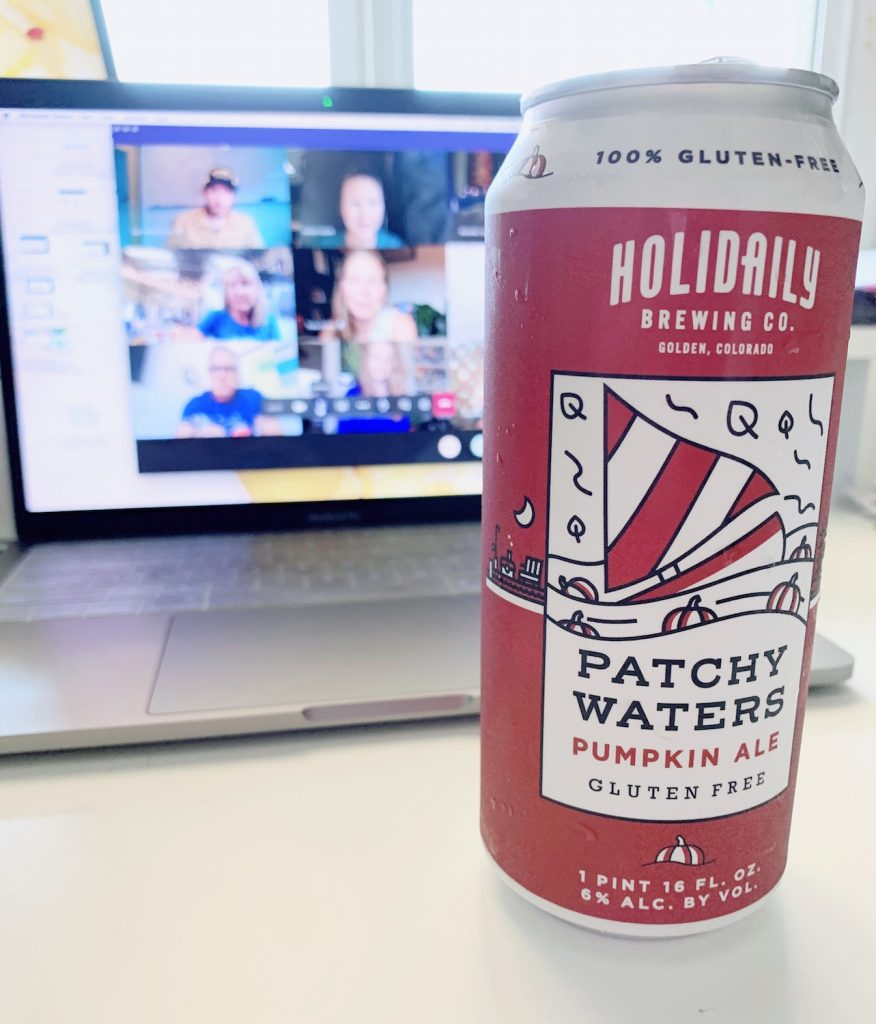 A Holidaily Brewing Company gluten-free Patchy Waters Pumpkin Ale can in front of a screen featuring blurred gluten-free bloggers doing a virtual tasting