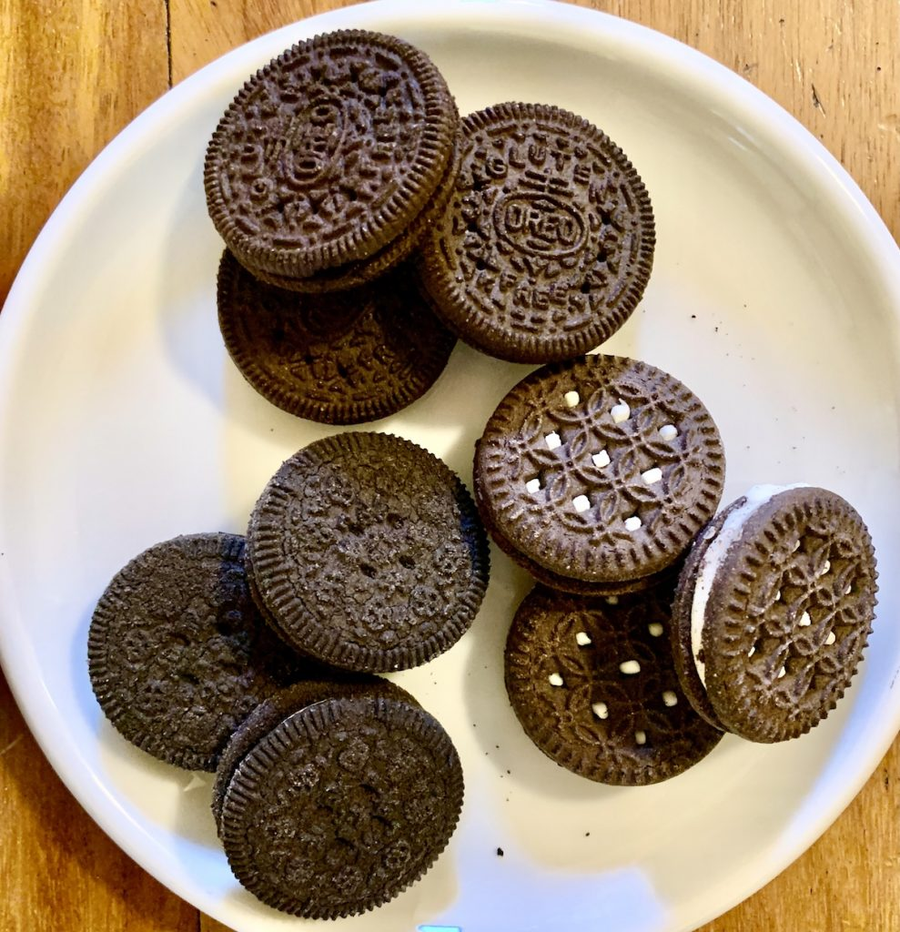 A plate featuring all three competitive gluten-free chocolate sandwich cookies - Oreo, Glutino and Kinnikinnick.