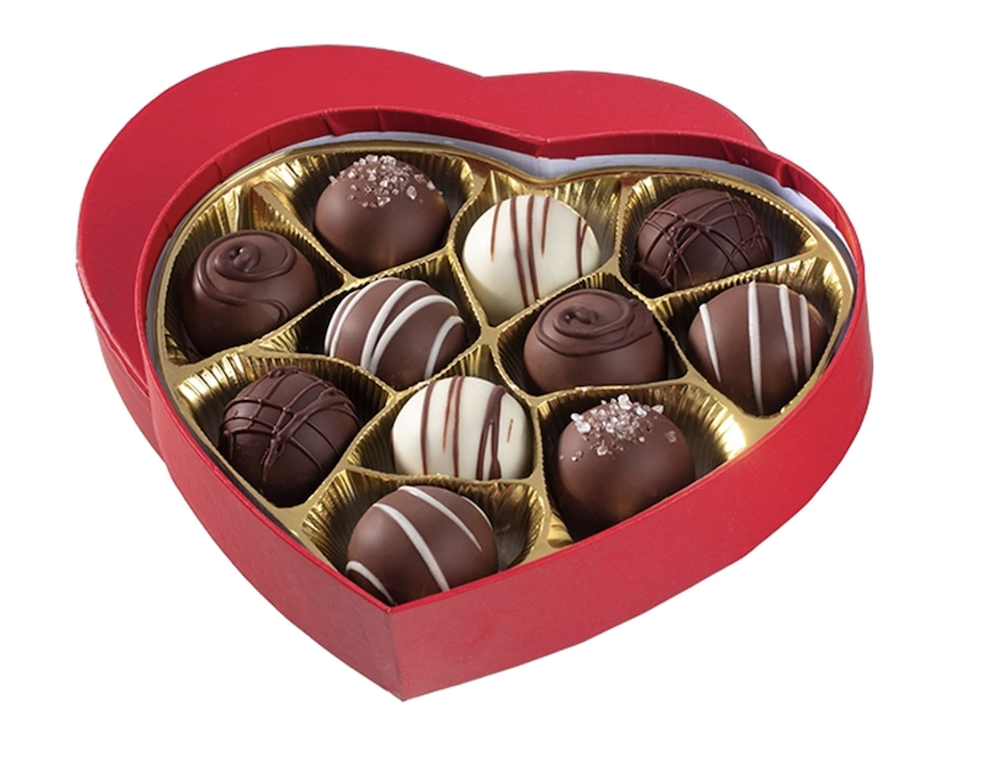 Heart-shaped red box, filled with No Whey Chocolate truffles