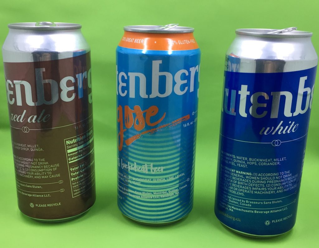 Three cans of Glutenberg Beer, Red Ale Gose Ale and White Ale on a green background