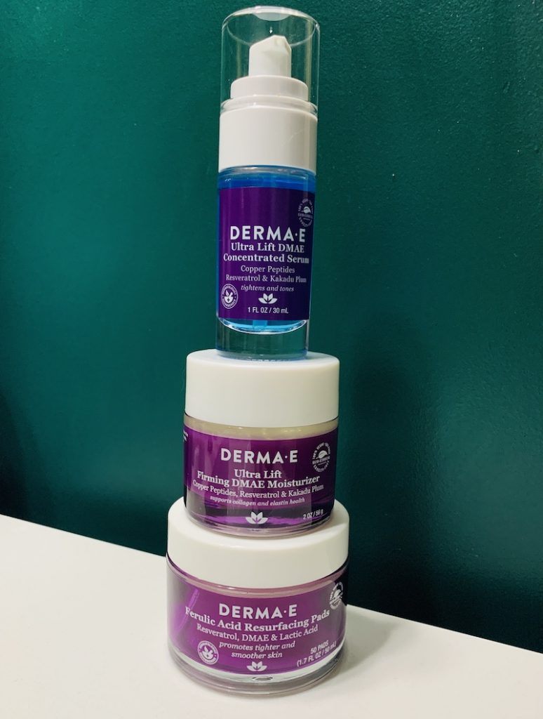 DermaE new DMAE collection, three products stacked on top of each other - serum, moisturizer, and resurfacing pads