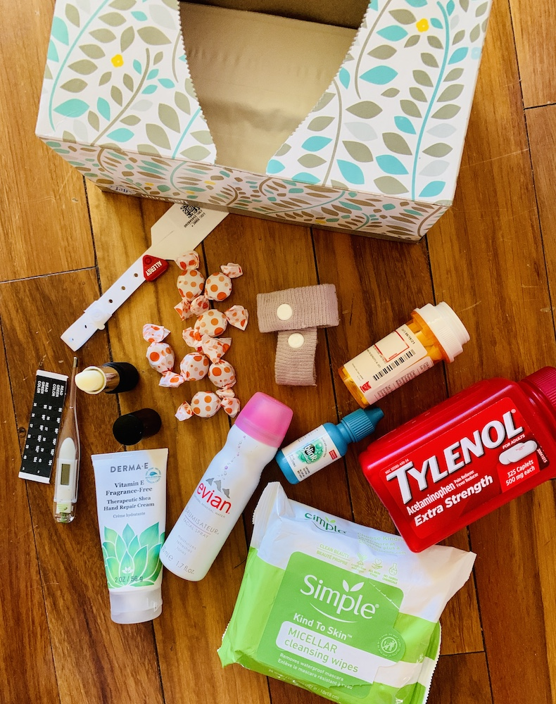 a collection of products that haleped with sinus surgery recovery including tissues, Tylenol, Sea-bands, anti-nausea ginger candy